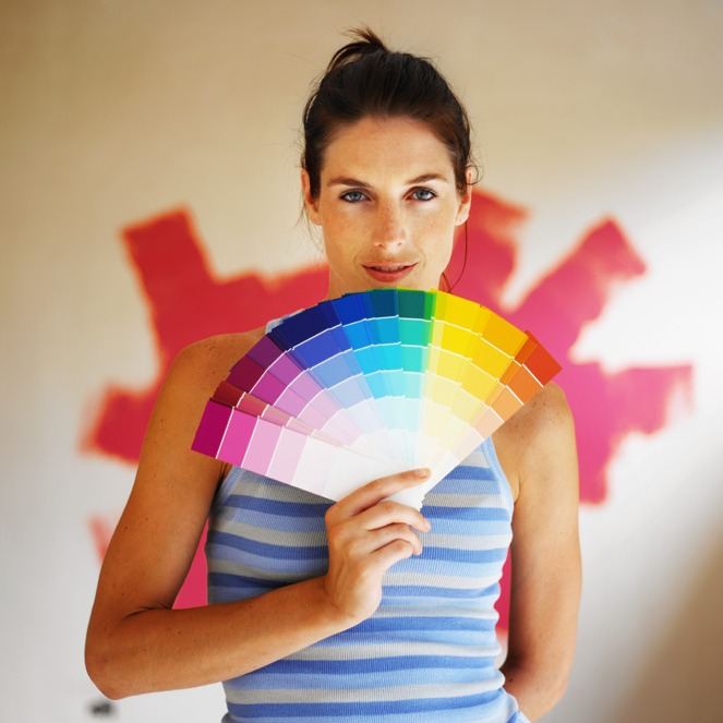 portrait of a young woman showing color sample chart
